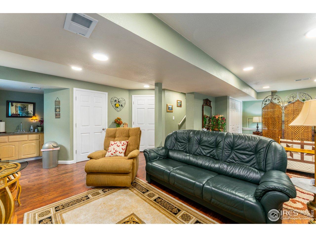 Basement featuring engineered hardwood floors