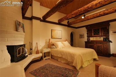 Large bedroom with fireplace