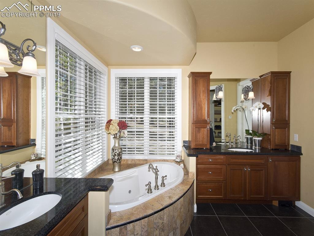 Master Bath with spa tub, beautiful cabinets and steam shower