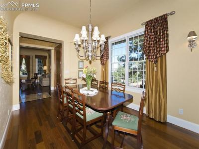 Formal Dining Room with windows framing pine-dotted countryside