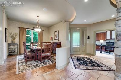 Entry wraps around to Formal Dining Room