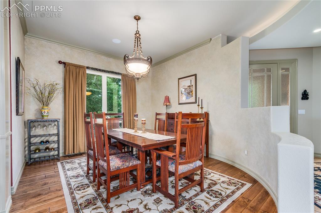 Formal Dining room accented by 1/2 wall, hardwood