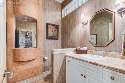 Elegant unique half bath on main floor!