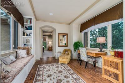 Bridge area to Master Suite~ well-appointed, bright space with Butler's Pantry!