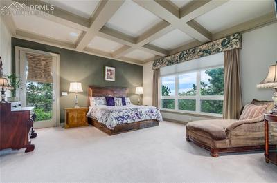 Master suite has its own patio; coffered ceilings