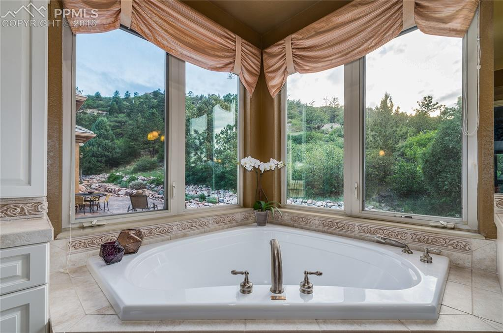 Mstr Bth has exquisite corner tub to enjoy views!