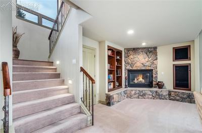 Lower level is enhanced with another fireplace, built-ins and plenty of storage.