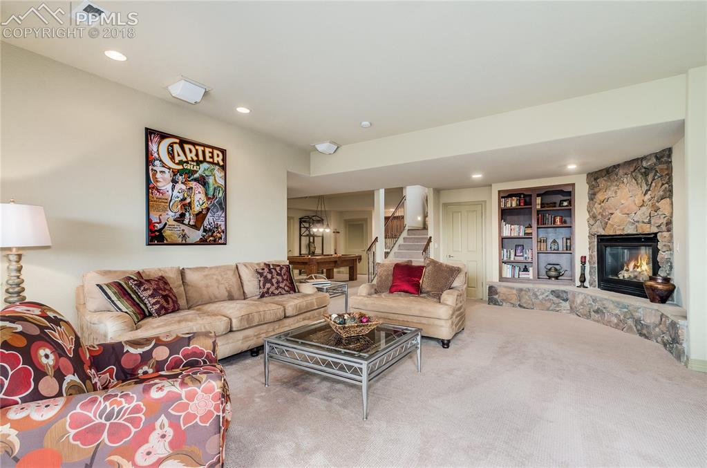 Perfect for entertaining!  Media/rec room and Pool table area with wet bar!