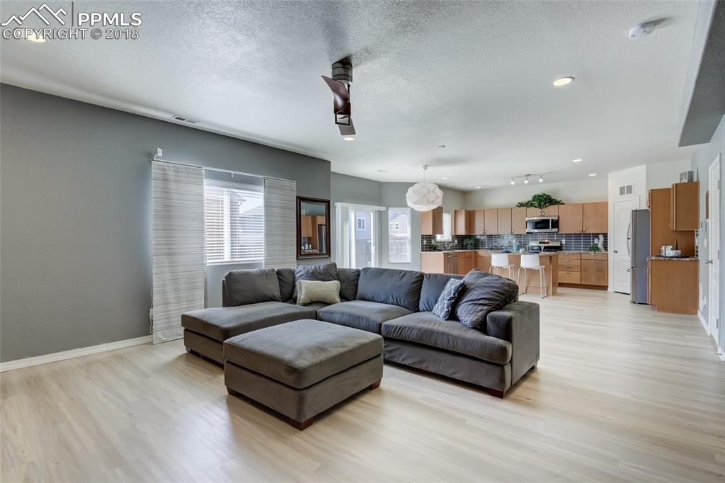 Open to the Kitchen and Dining area - can lighting plus lots of windows!