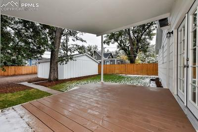 Large covered back deck with back yard.