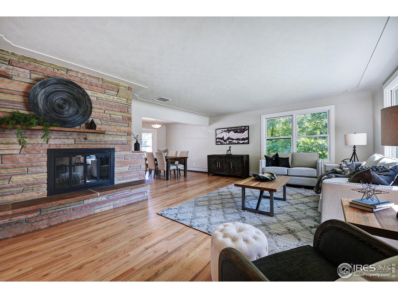 Living room with original flagstone fireplace