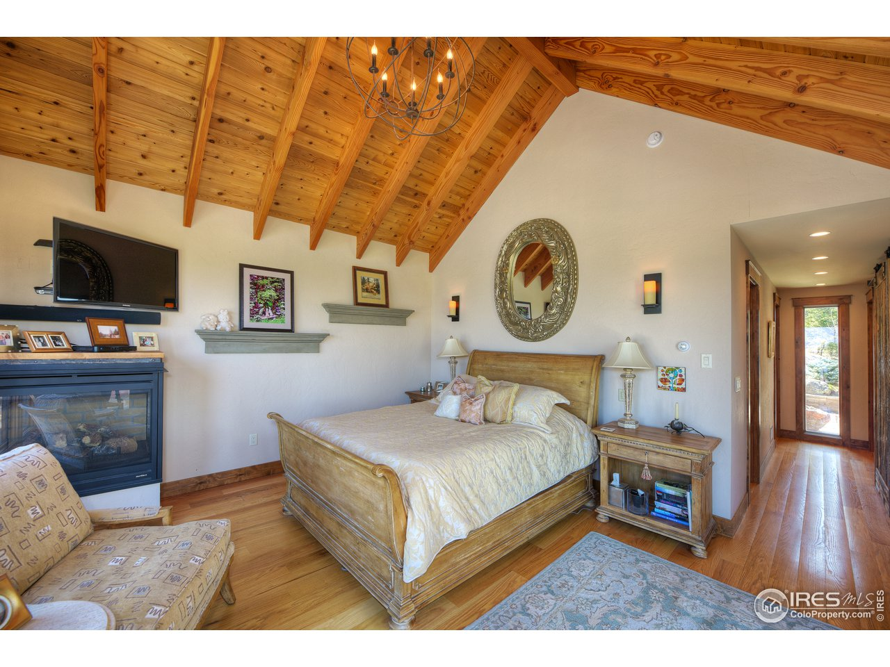 Romantic master suite with fireplace & views