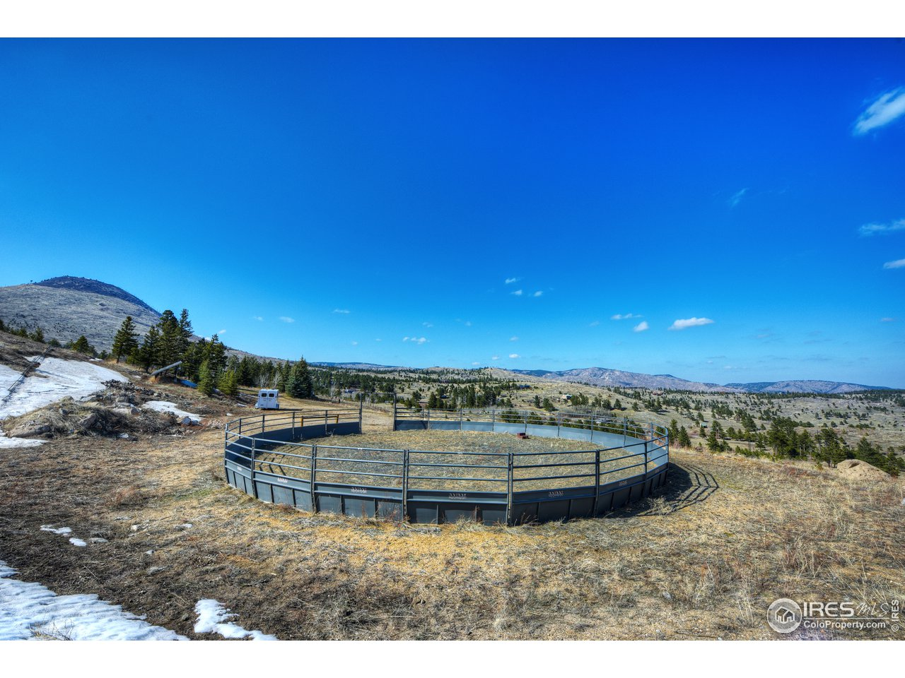 15.5 acres with fenced corrals,  pastures