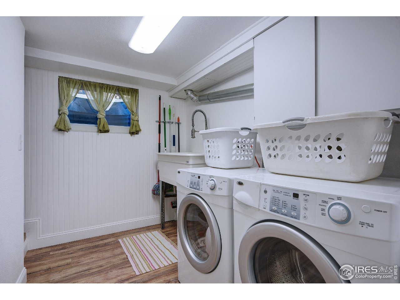 Great laundry room with laundry tub & storage