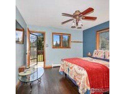 Main level bedroom with door to exterior deck