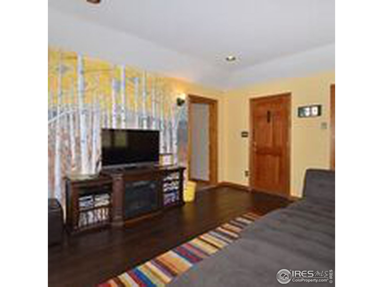 Main level living room w door to outside