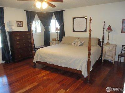 Master Bedroom with Wood Floors & 3 Large Windows