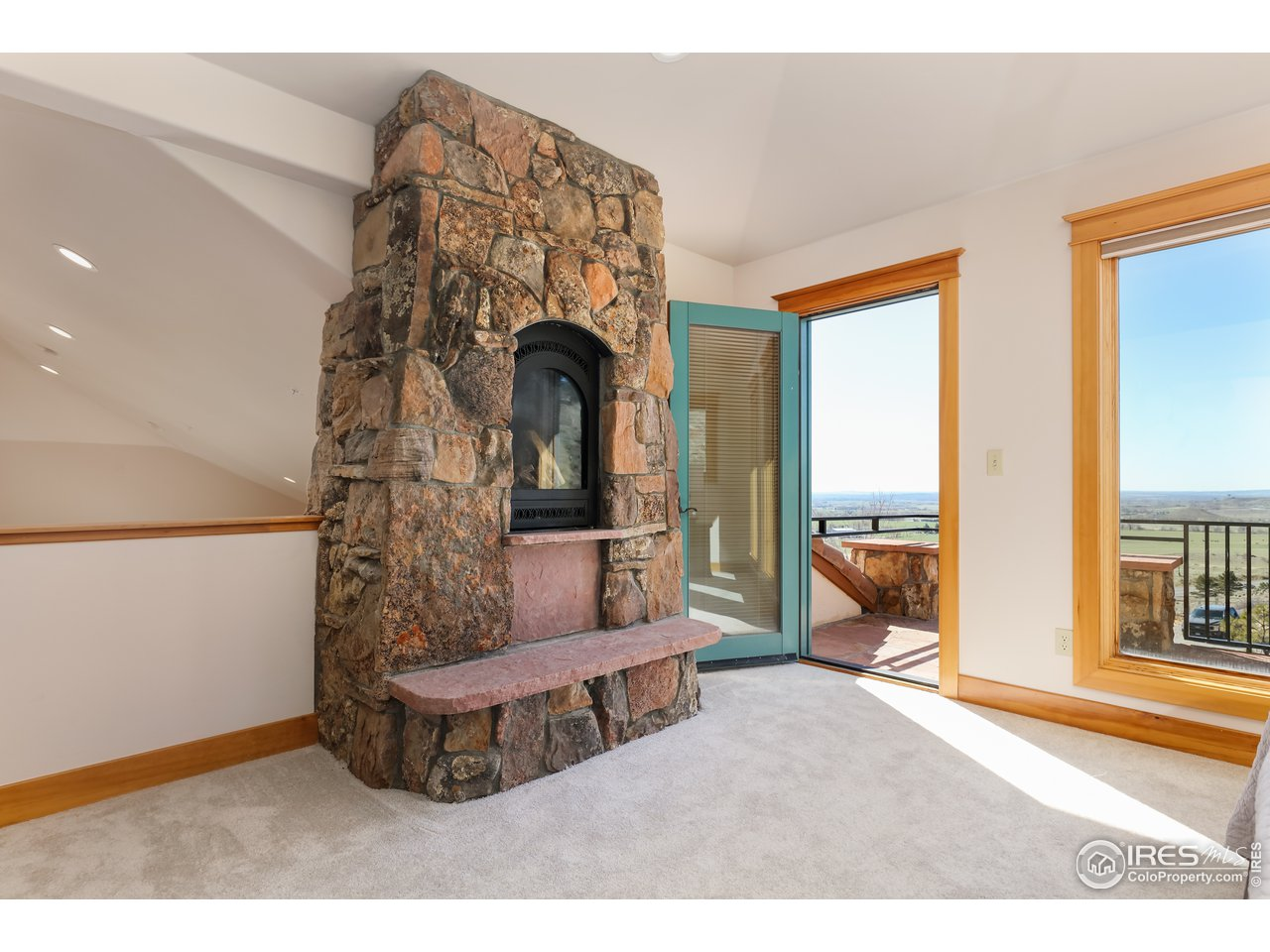 Primary bedroom fireplace and deck access
