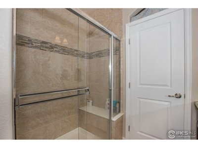 A beautifully tiled master walk in shower