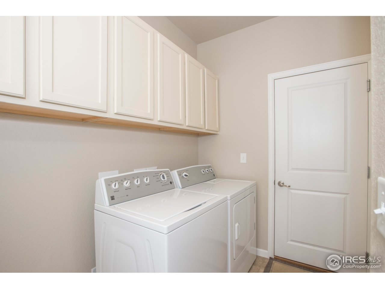 Enjoy plenty of cabinet space in your laundry room
