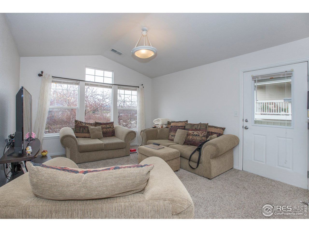 Stairwell opens to a bright living room