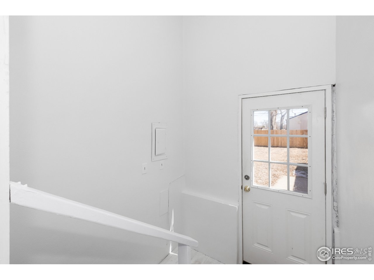 Back door leads to the shared laundry room