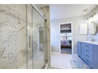 Remodeled master bath w/ custom glass shower