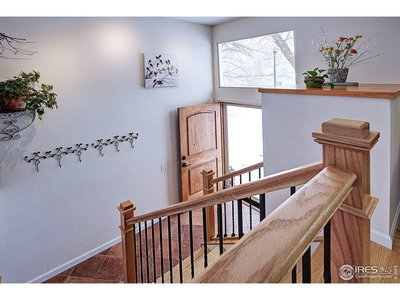 Entry with custom stair railings