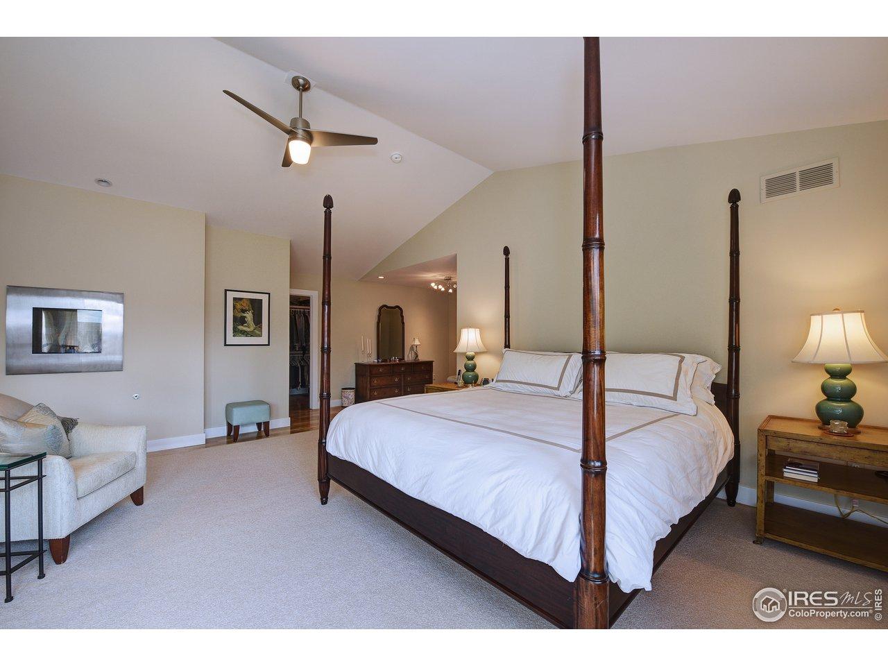 Vaulted ceilings, wood floors under rug