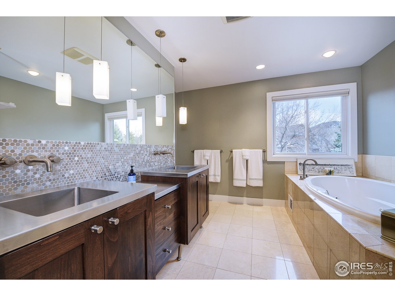 Master bath with stainless steel vanities
