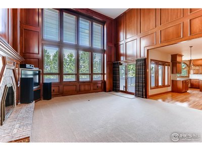 Family Room w/ 2-Story Ceilings & Windows