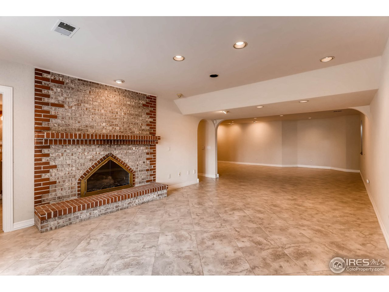 Brick Gas Fireplace in Rec. Room