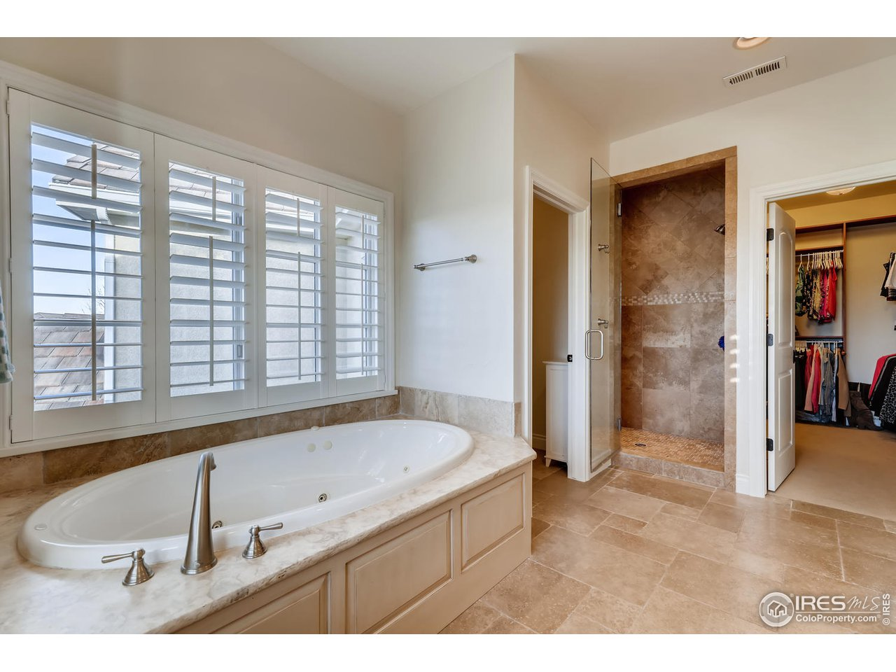 Steam Shower, Jetted Tub & Custom Closet