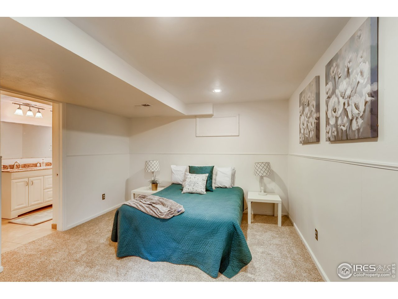 Basement bedroom.  Note bathroom off of bedroom