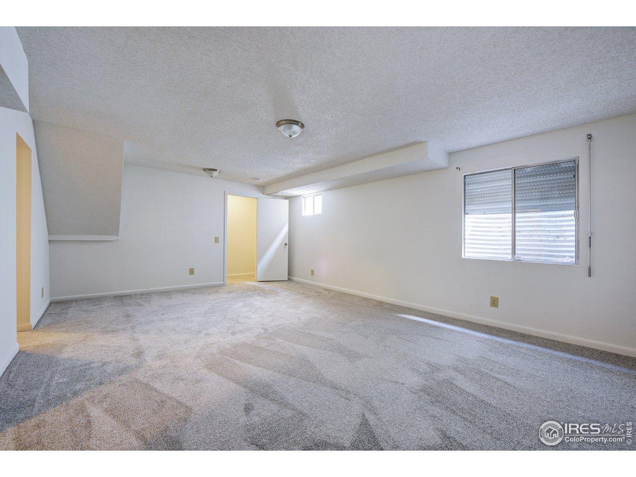 Basement has huge rec room & egress window