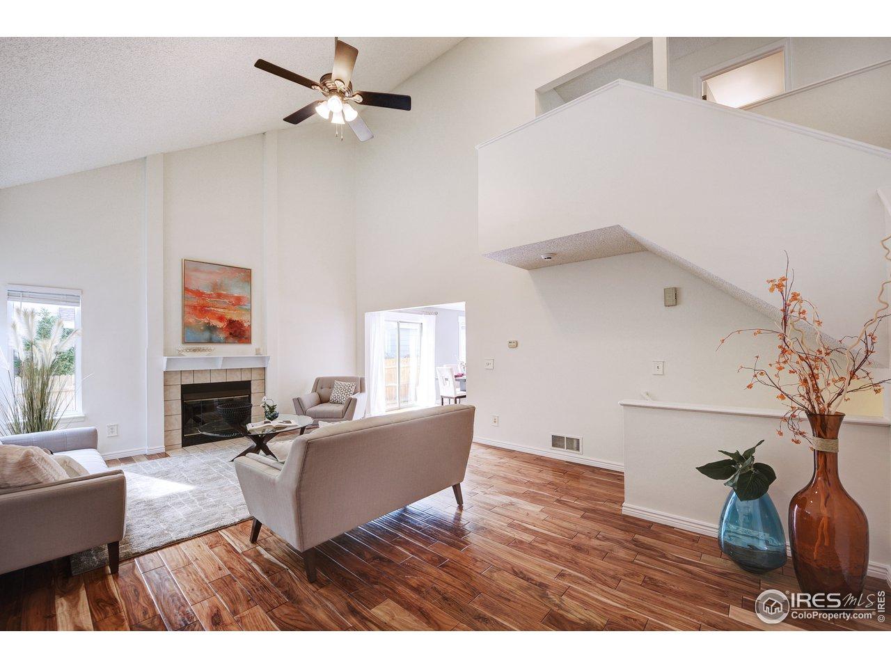 Elegant Great Room with Acacia wood floors