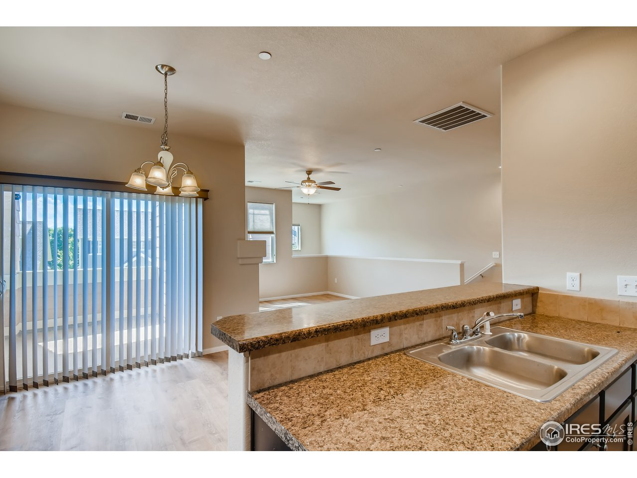 Open Kitchen and Dining with Easy Access to Balcony