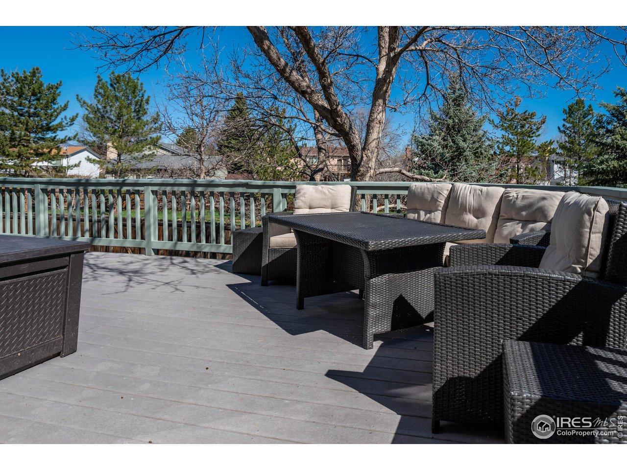 Enjoy indoor/outdoor living on large deck overlooking greenbelt
