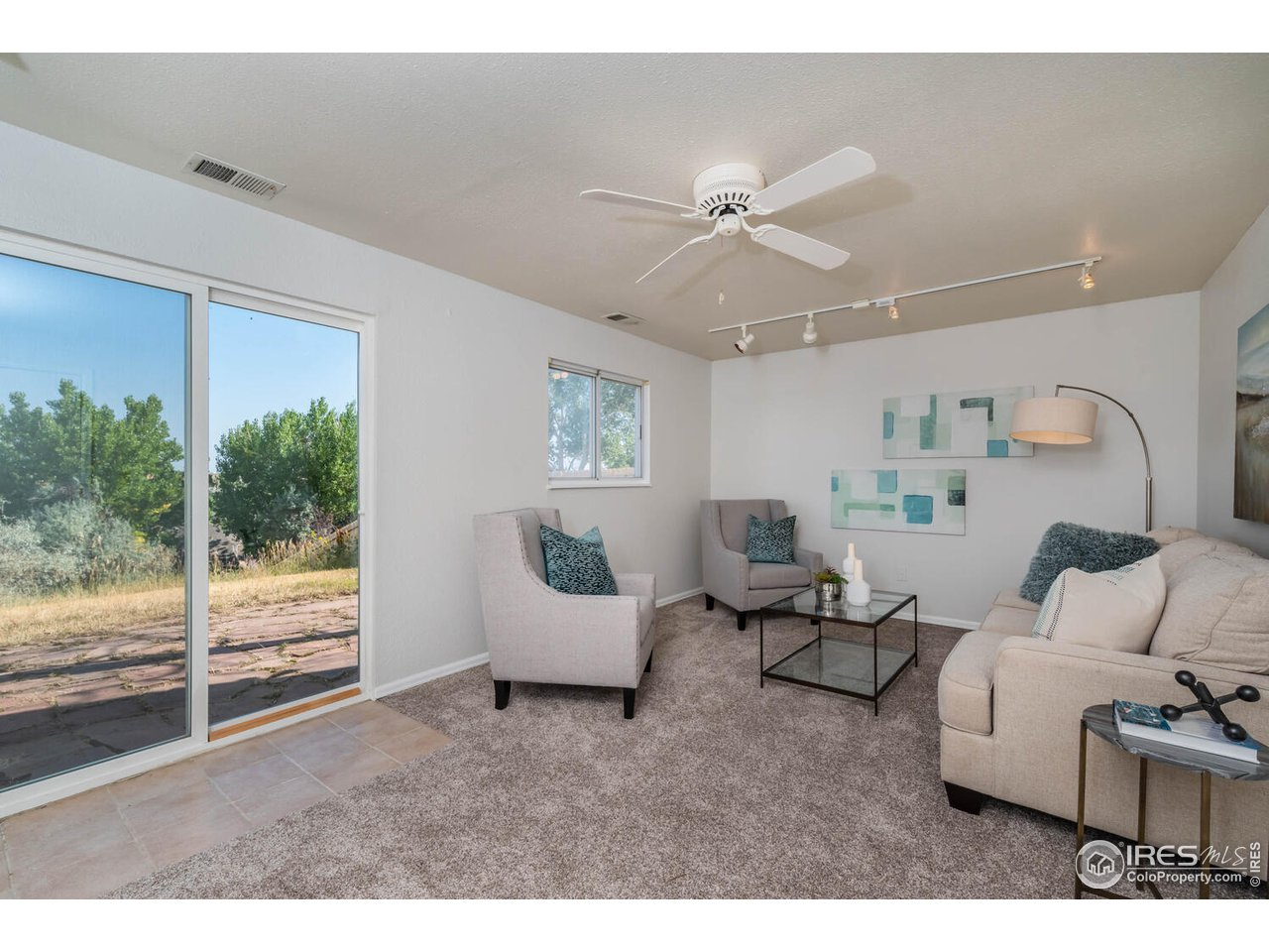 Family room with sliding glass door to back yard and flagstone patio