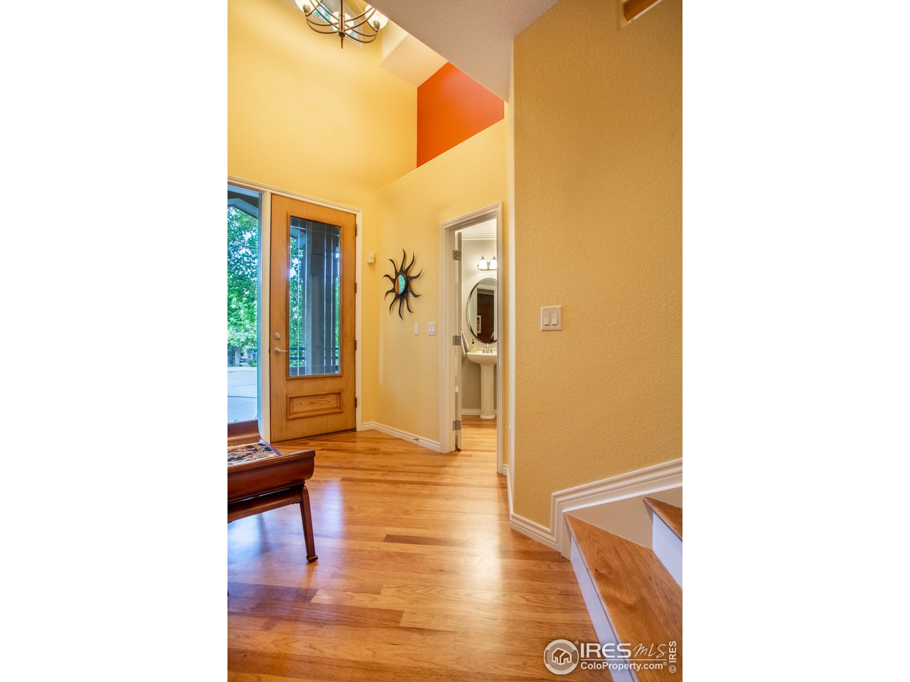 Entry hall leads main level dining room & kitchen
