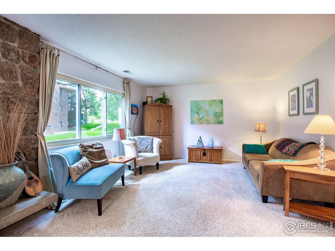Living room overlooking HOA greenbelt