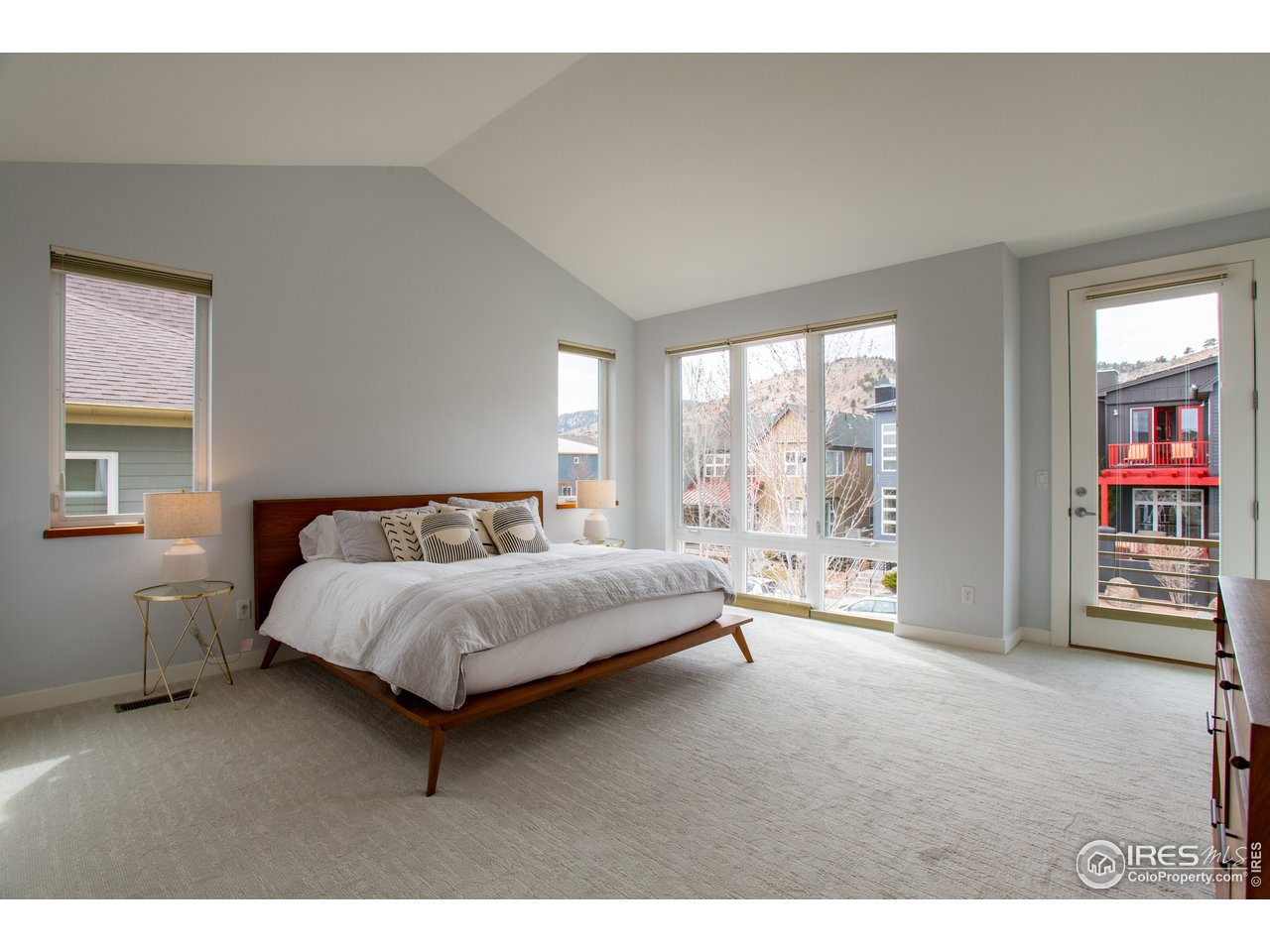 Primary bedroom with lovely Foothills views