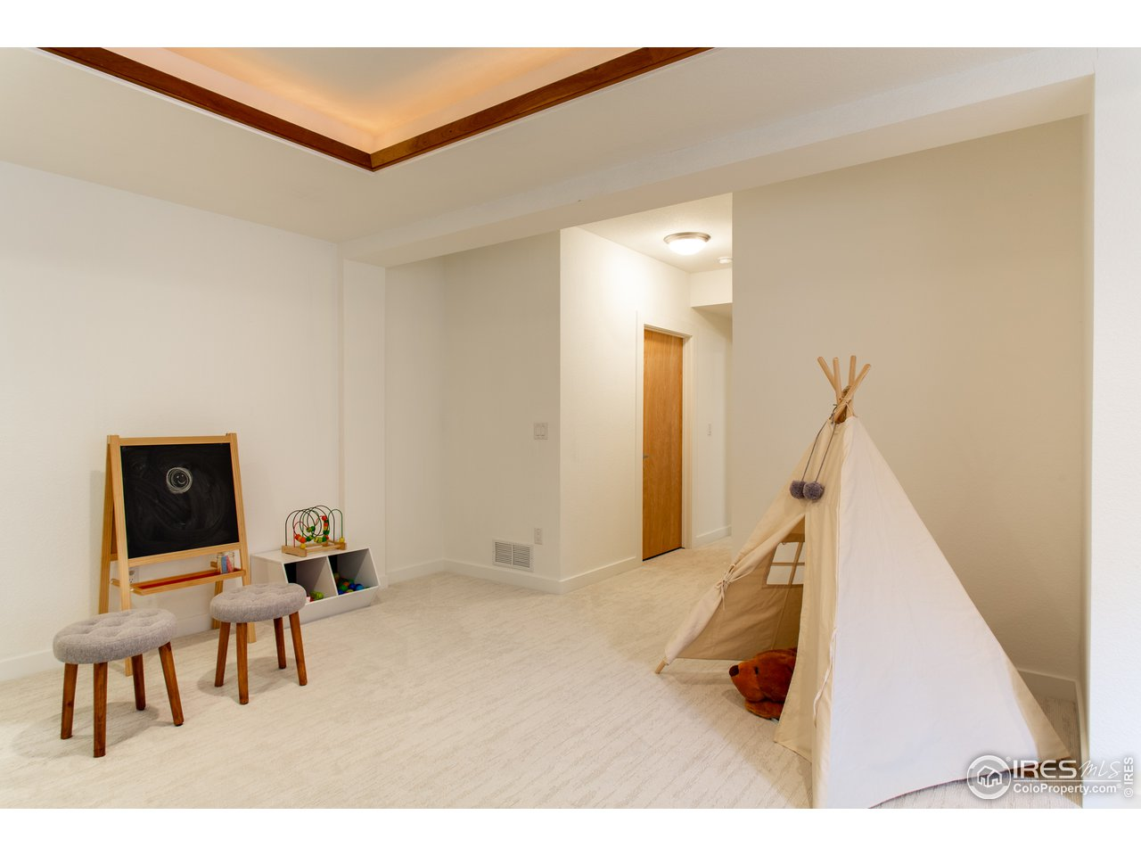 Hall off rec room leading to 4th bedroom and bath