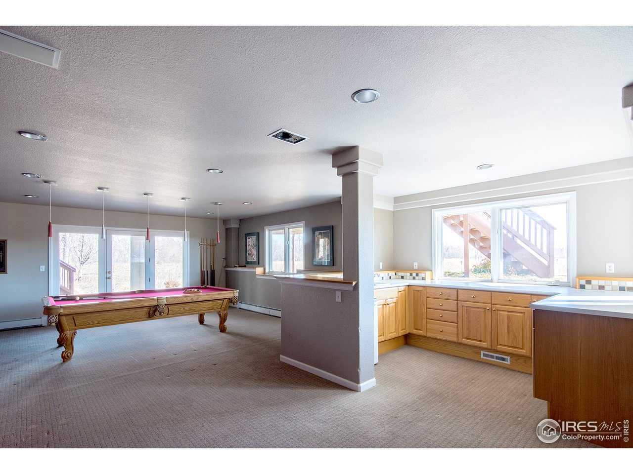 Rec room with wet bar. Pool table stays!