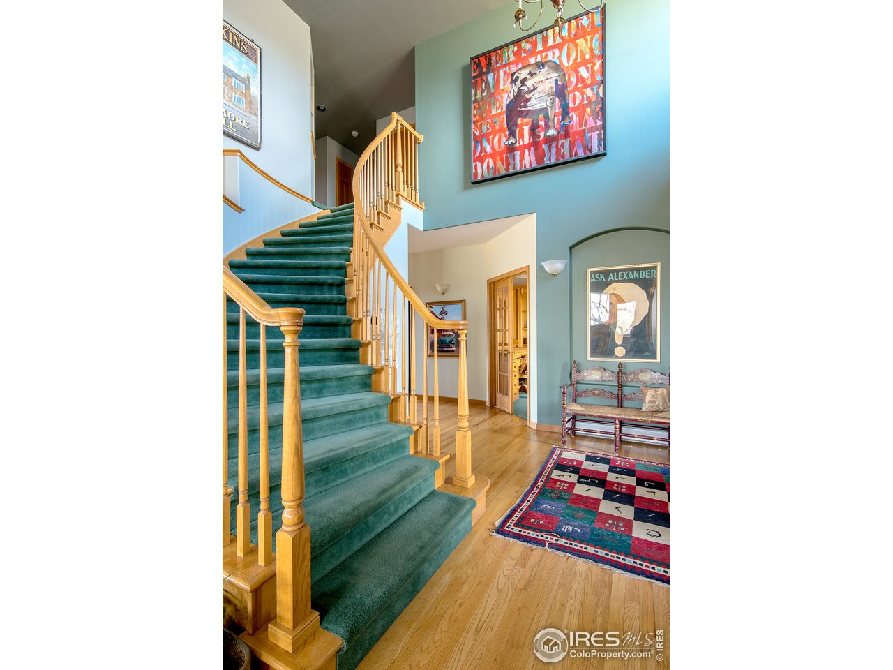 Grand curved staircase entryway