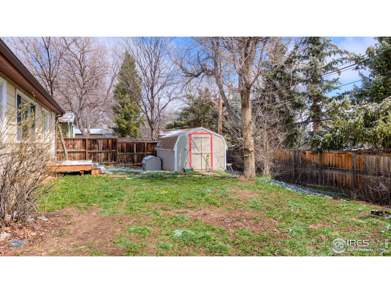 Big storage shed included. Fully fenced back yard.