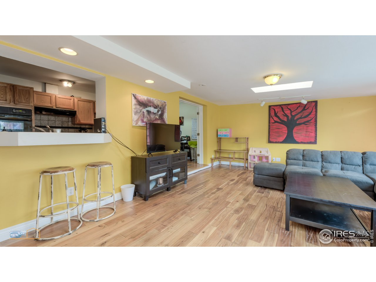 Opens to kitchen and dining room