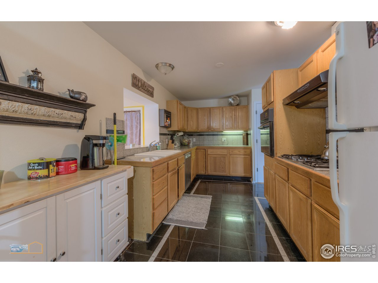 Kitchen with maple cabinetry