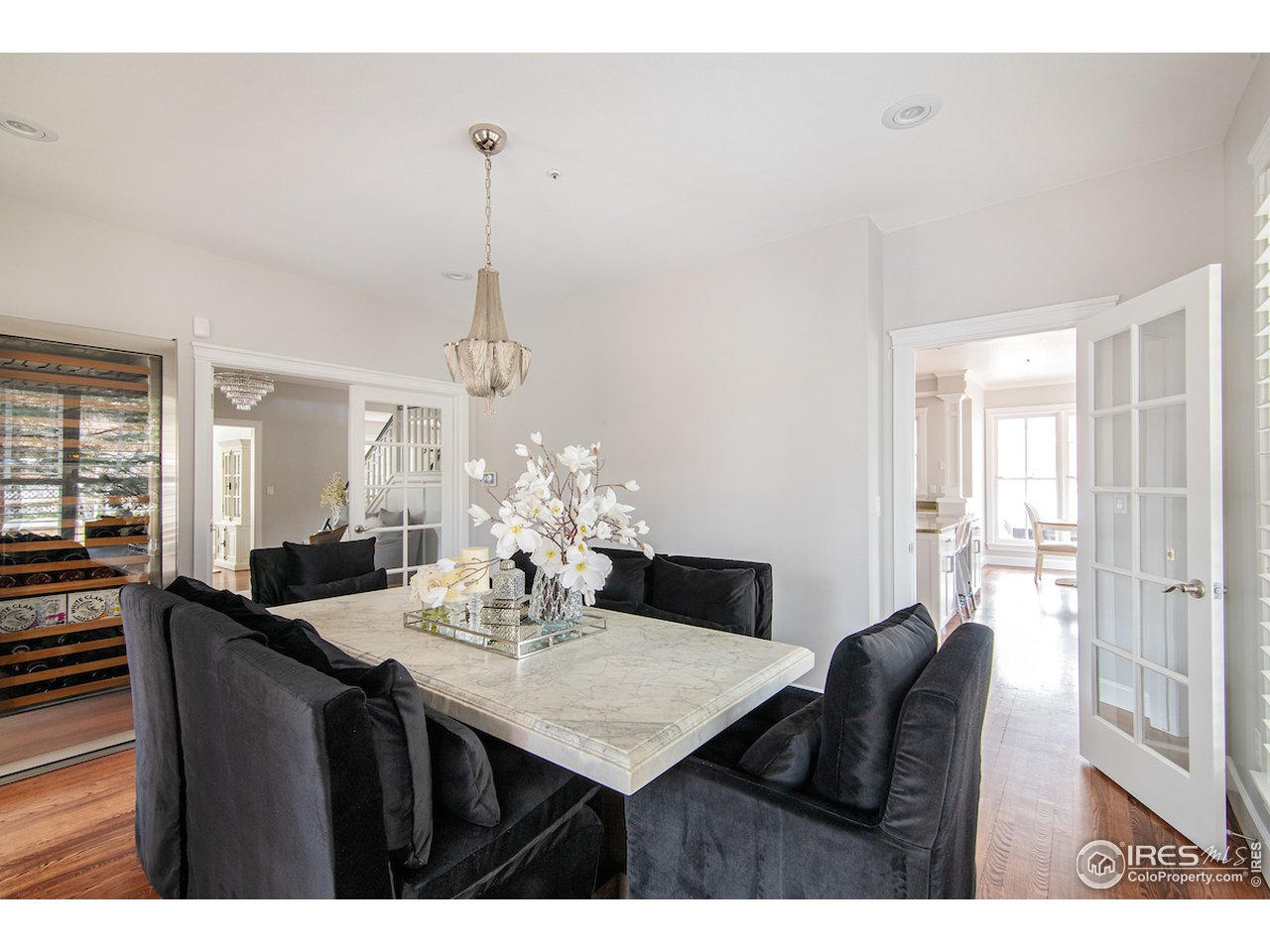 Formal dining room with french doors & entry from kitchen