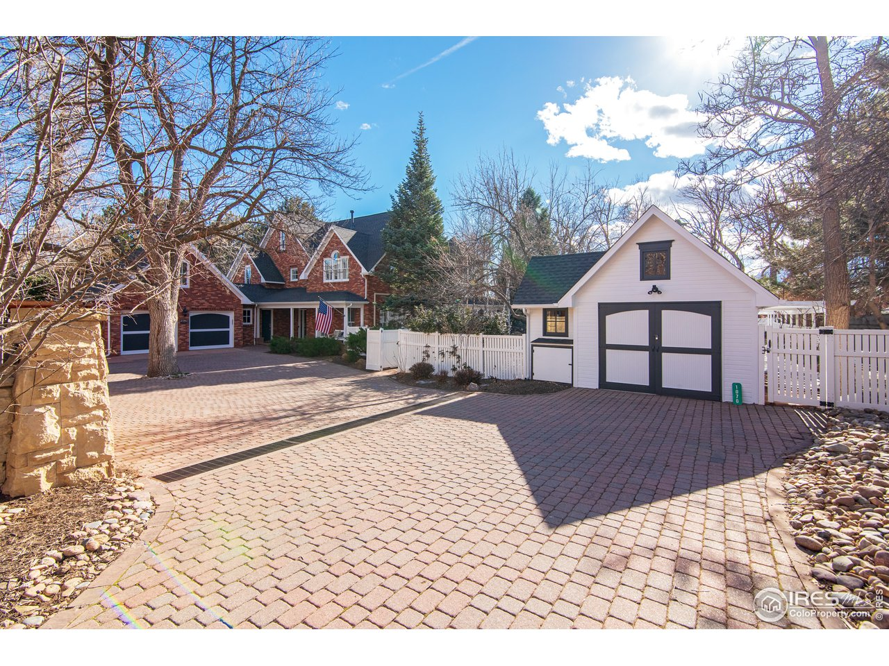 Driveway entry with detached one car garage